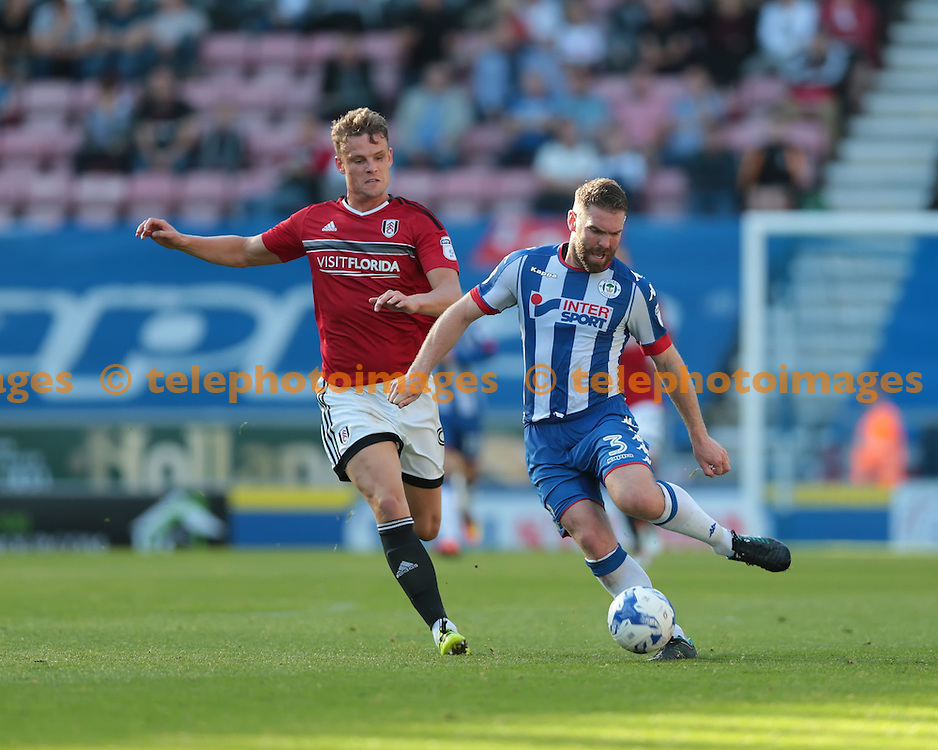 Wigan Athletic defender Jake Buxton (3) lays the ball back during the Sky Bet Championship match between Wigan Athletic and Fulham at the DW Stadium in Wigan. September 17, 2016.<br /> Nigel Pitts-Drake / Telephoto Images<br /> +44 7967 642437