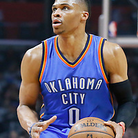 21 December 2015: Oklahoma City Thunder guard Russell Westbrook (0) eyes the basket during the Oklahoma City Thunder 100-99 victory over the Los Angeles Clippers, at the Staples Center, Los Angeles, California, USA.
