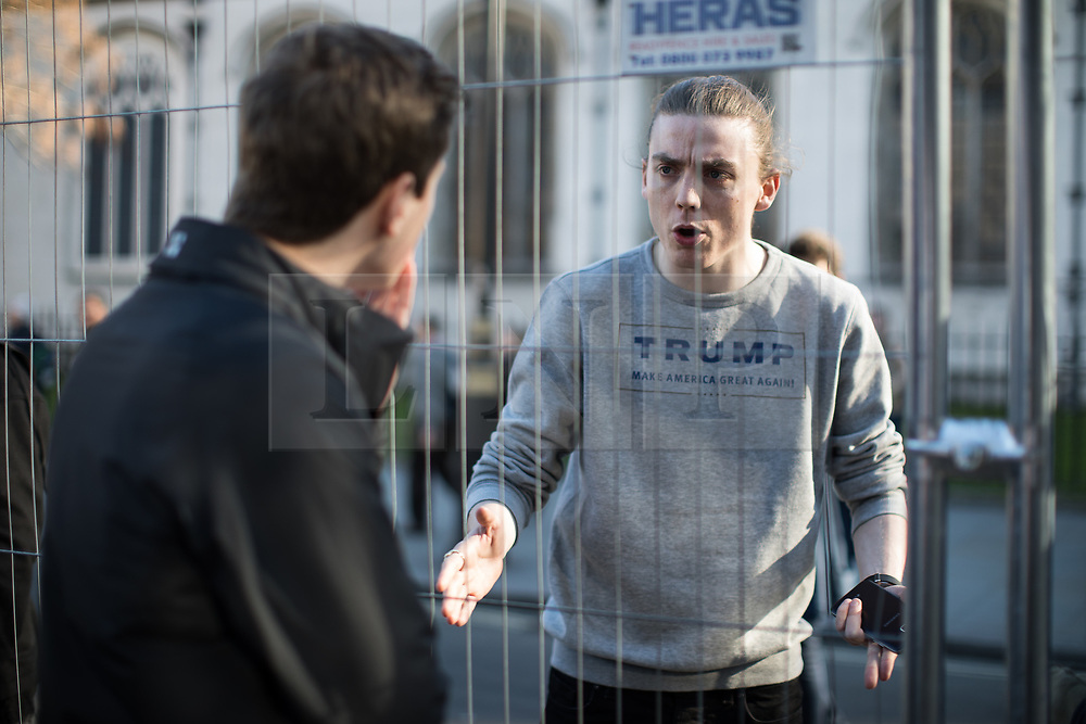 © Licensed to London News Pictures . 25/03/2017 . London , UK . An English Donald Trump supporter argues with a pro-Europe supporter . A Unite for Europe anti Brexit march through central London , from Park Lane to Westminster . Protesters are campaigning ahead of the British government triggering Article 50 of the Lisbon Treaty which will initiate Britain's withdrawal from the European Union . Photo credit : Joel Goodman/LNP