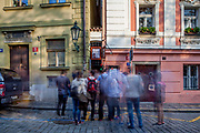 """Visitors are waiting to enter Prague's narrowest street which has a traffic light for pedestrians and leads to a restaurant located at """"Certovka"""" (Devil's Canal"""" at Lesser Town"""" (Mala Strana)."""