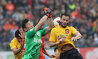 Alberto Gilardino of Guangzhou Evergrande, right, challenges goalkeeper Zhang Lie of Guizhou Renhe during the 28th round of the 2014 Chinese Football Association Super League in Guiyang city, southwest China's Guizhou province, 18 October 2014.<br /> <br /> Guangzhou Evergrande defeated Guizhou Renhe 2-1.