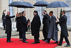 French President Emmanuel Macron and his wife Brigitte Macron welcome King Mohammed VI of Morocco and his son Hassan at the Elysee Palace, ahead of the international ceremony for the Centenary of the WWI Armistice of 11 November 1918, in Paris, France on November 11, 2018. Photo by Christian Liewig/ABACAPRESS.COM