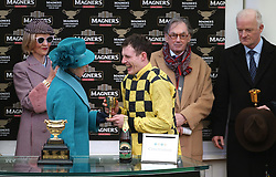 The Princess Royal presents Jockey Paul Townend (right) with the trophy after winning the Magners Cheltenham Gold Cup Chase on Al Boum Photo during Gold Cup Day of the 2019 Cheltenham Festival at Cheltenham Racecourse.