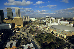 Daytime aerial of downtown Houston, Texas featuring the Toyota Center and NRG Stadium.