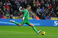 Man city  goalkeeper Joe Hart in action.  Barclays Premier league, Swansea city v Manchester City at the Liberty Stadium in Swansea,  South Wales on  New years day Wed 1st Jan 2014 <br /> pic by Andrew Orchard, Andrew Orchard sports photography.
