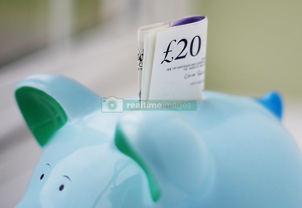 File photo dated 06/01/15 of money in a piggy bank, as AprilÕs pay packets may be looking a bit lighter for some people, as new rules have come into force which means more cash is being funnelled into workplace pensions.