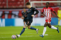 PIRAEUS, GREECE - NOVEMBER 25: John Stones of Manchester City and Mohamed Camara of Olympiacos FC during the UEFA Champions League Group C stage match between Olympiacos FC and Manchester City at Karaiskakis Stadium on November 25, 2020 in Piraeus, Greece. (Photo by MB Media)