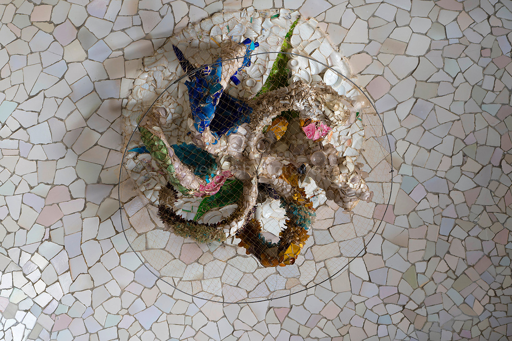 Mosaic on the ceiling of Sala de les Cent Columnes or Sala Hipóstila - Parc Guell, Barcelona, Catalonia, Spain. A public park design by famed Catalan architect Antoni Gaudi featuring gardens and architectural curiosities.