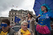 With one year to go until Brexit, anti-Brexit, pro-Europe demonstrators protest in favour of staying in the European Union aboard an EU superhero Brexit battle bus on 29th March 2018 in London, England, United Kingdom. As the Tories continue their negotiations with EU leaders, protesters make their views heard throughout the capital.