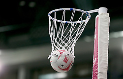 A general view of a netball dropping through the net