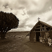 """""""African Schoolhouse""""                                        Tanzania<br />  A bench, a tree, a building/church. These are the schools of Africa."""