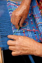 North America, Mexico, Oaxaca Province, Oaxaca, hands weaving with loom