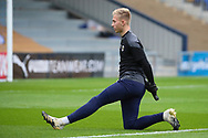 AFC Wimbledon goalkeeper Matt (Matthew) Cox (21) warming up prior to kick off during the The FA Cup match between AFC Wimbledon and Crawley Town at Plough Lane, London, United Kingdom on 29 November 2020.