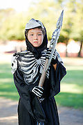 Aidan Do, 6, of Milpitas wears a skeleton costume during the annual Sunnyhills Neighborhood Association's Sunnyhills Pre-Halloween Party at Albert Augustine Jr. Memorial Park in Milpitas, California, on October 26, 2013. (Stan Olszewski/SOSKIphoto)