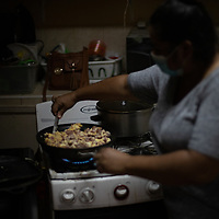 Noemí Santillo, from Jerusalén neighbourhood in San Pedro Sula, cooks food for people who have left their flooded houses and are living in a shelter provided at a school run by the Episcopal Church of Honduras. Noemí left her house when the flood water was chest height.