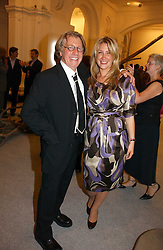 Art collector FRANK COHEN and his daughter GEORGINA COHEN at a reception o celebrate the opening of 'USA Today' - an exhibition of work from The Saatchi Gallery held at The Royal Academy of Arts, Burlington Gardens, London on 5th September 2006.<br /><br />NON EXCLUSIVE - WORLD RIGHTS