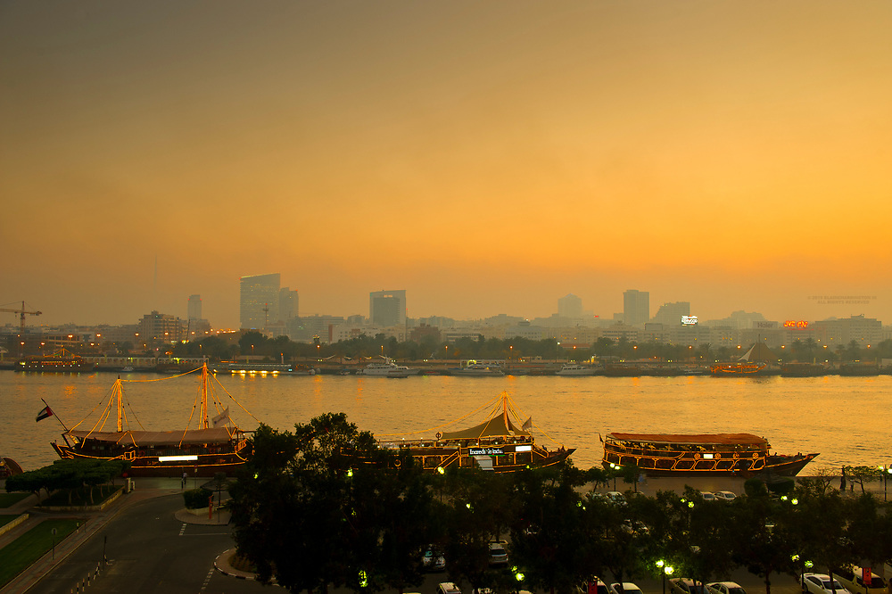View from the Deira side of Dubai Creek with dhows lined up on the shore, Dubai, United Arab Emirates