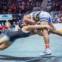 Capital Jaguar shoots on Kirtland Central Bronco Isaac Thomas during the 2018 New Mexico High School Wrestling Championship at the Santa Ana Star Center in Rio Rancho Saturday.