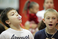 Middletown, New York - Boys blow bubbles during a contest at Family Night at the Middletown YMCA on April 2, 2011.