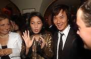 Andy and Patti Wong. charles Finch and Chanel 6th Anniversary Pre-Bafta party to celebratew A Great Year of Film and Fashion Beyond the Red Carpet at Annabel's. Berkeley Sq. London W1. 18 February 2006. ONE TIME USE ONLY - DO NOT ARCHIVE  © Copyright Photograph by Dafydd Jones 66 Stockwell Park Rd. London SW9 0DA Tel 020 7733 0108 www.dafjones.com