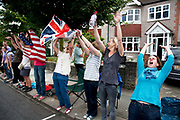 London, UK. Wednesday 1st August 2012. The Men's Individual Time Trial cycling event passes through Twickenham on route to find the fastest male cyclist. Local supporters try to start a Mexican wave.