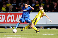 AFC Wimbledon striker Andy Barcham (17) battles for possession withOxford United attacker Gaving Whyte (16) during the EFL Sky Bet League 1 match between AFC Wimbledon and Oxford United at the Cherry Red Records Stadium, Kingston, England on 29 September 2018.