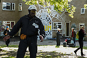 Bailiffs escort housing activists away from properties from which they were evicted on the Sweets Way housing estate on 23rd September 2015 in London, United Kingdom. A group of housing activists calling for better social housing provision in London had occupied some of the properties on the 142-home estate in Whetstone, in some cases refurbishing properties intentionally destroyed by the legal owners following eviction of the original residents, in order to try to prevent the eviction of the last resident on the estate and the planned demolition and redevelopment of the entire estate by Barnet Council and Annington Property Ltd.