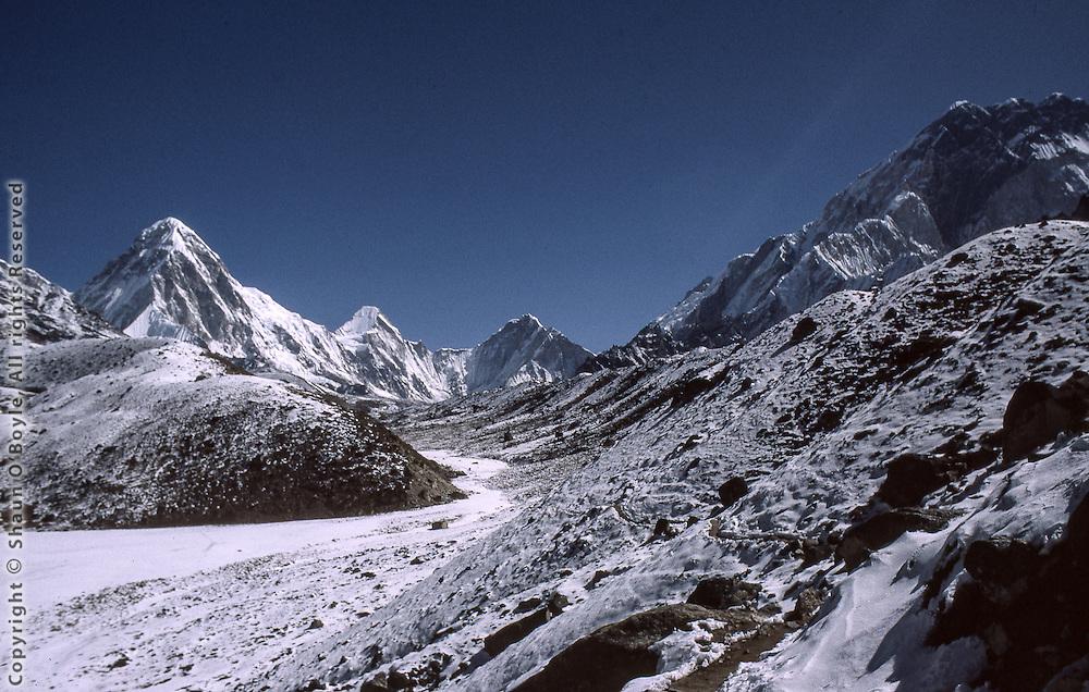 On the Khumbu Glacier trekking toward Gorak Shep and Everest Base Camp. Pumori is dominant on left.