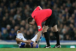 Match referee Chris Kavanagh checks on the condition of Everton's Richarlison after he picked up an injury