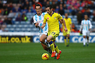 Lewis Cook of Leeds United Makes a break. Skybet football league Championship match, Huddersfield Town v Leeds United at the John Smith's Stadium in Huddersfield, Yorks on Saturday 7th November 2015.<br /> pic by Chris Stading, Andrew Orchard sports photography.