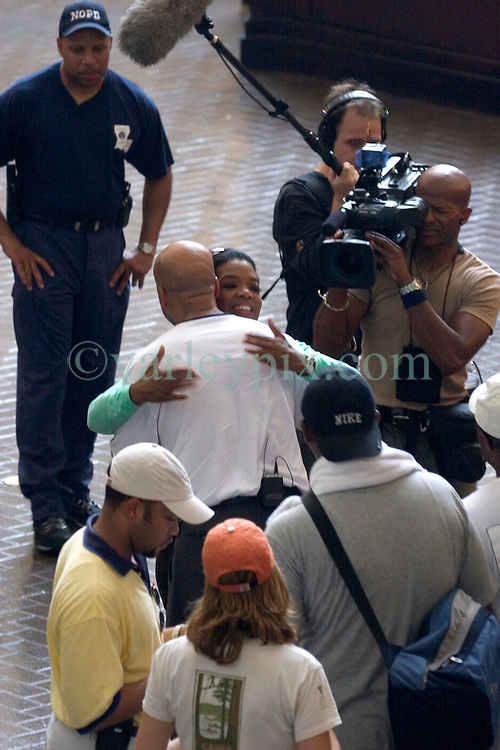 04 Sept  2005. New Orleans, Louisiana. Post hurricane Katrina.<br /> Oprah Winfrey, US talk show host, visits the Hyatt Hotel in New Orleans as she prepares to survey the hurricane damage. Oprah meets the Mayor of New Orleans, Ray Nagin with a hug.<br /> Photo Credit ©: Charlie Varley/varleypix.com