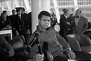 Muhammad Ali In Dublin..1972..11.07.1972..07.11.1972..11th July 1972..Prior to his fight against Al 'Blue' Lewis at Croke Park, Dublin, former World Heavyweight Champion, Muhammad Ali arrives at Dublin Airport. The fight was part of his build up for for a championship fight against the current World Champion, 'Smokin'  Joe Frazier. Ali had been stripped of the title partly due to his refusal to join the American military during The Vietnam War, which he had opposed...Image of Muhammad Ali as he examines a shillelagh which was presented to him on his arrival in Dublin.