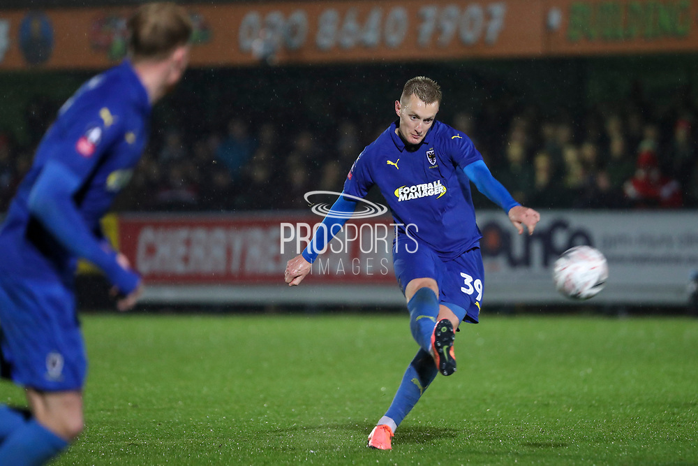 AFC Wimbledon striker Joe Pigott (39) hitting a free kick during the The FA Cup match between AFC Wimbledon and Doncaster Rovers at the Cherry Red Records Stadium, Kingston, England on 9 November 2019.