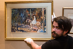 """Bonhams, Mayfair, London, February 26th 2016. A gallery technician displays """"Portrait of Mrs Abigail Prince"""" by Sir Alfred Munnings estimated to fetch between £40-60,000 at the Bonhams 19th Century Art Sale in Mayfair, London on March 2nd 2016. ///FOR LICENCING CONTACT: paul@pauldaveycreative.co.uk TEL:+44 (0) 7966 016 296 or +44 (0) 20 8969 6875. ©2015 Paul R Davey. All rights reserved."""