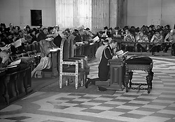 King George VI and Queen Elizabeth bow in prayer at St Paul's Cathedral.