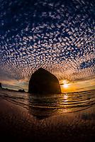 Haystack Rock at sunset, Cannon Beach, Oregon USA.