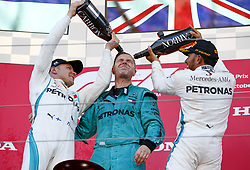 October 7, 2018 - Suzuka, Japan - Mercedes AMG Petronas F1 drivers VALTTERI BOTTAS, left, and LEWIS HAMILTON, right, celebrate on the podium with Mercedes Chief Mechanic MATT DEANE after Bottas and Hamilton finished 2nd and 1st respectively in the Formula One Grand Prix of Japan, at Suzuka. (Credit Image: © Hoch Zwei via ZUMA Wire)