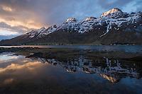 Spring snow mountain reflection in Skjelfjord, Flakstadøy, Lofoten Islands, Norway