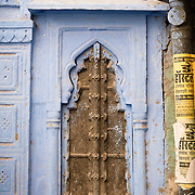 Blue wall and arched window in old city of Jodhpur