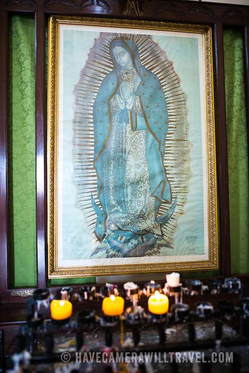 A replica of the famous painting of Our Lady of Guadalupe in the the Cathedral de Granada. There has been a church on this spot since about 1525, but it was destroyed and rebuilt several times in the following centuries as the city of Granada was attacked by pirates and others. Construction on the current version began in 1888 but was not fully completed until 1972. With its distinctive yellow with white trim exterior, it stands over Parque Central in the heart of Granada, Nicaragua.