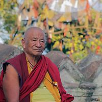 Asia, Nepal, Kathmandu. Monk and prayer flags.