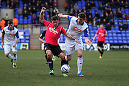 Oldham Athlteic's Chrlie MacDonald battles with Tranmere Rovers' Ash Taylor. Skybet football league 1match, Tranmere Rovers v Oldham Athletic at Prenton Park in Birkenhead, England on Saturday 1st March 2014.<br /> pic by Chris Stading, Andrew Orchard sports photography.
