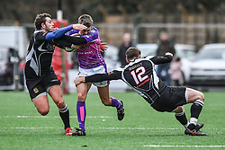 Pontypridd's Alex Webber is tackled by Bedwas's Mike Callow and Steffan Jones  - Mandatory by-line: Craig Thomas/Replay images - 30/12/2017 - RUGBY - Sardis Road - Pontypridd, Wales - Pontypridd v Bedwas - Principality Premiership