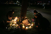 Hundreds of people gathered at a peaceful vigil for Sarah Everard on Clapham Common in South London on the 13th of March 2021, London, United Kingdom. Sarah Everard went missing on 3 March after setting off at 9pm from a friend's house to make her two and a half mile journey home. Candles and flowers for Sarah Everard. The vigil was also a call to end violence against girls and women perpetrated by men. The vigil was not sanctioned by police because of Covid restrictions and the police decided to arrest a number of people in an attempt to end the peaceful and highly emotional vigil. The event took place at the band stand on the common and speeches were held from the stand till police confiscated the sound equipment.