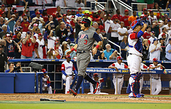 March 11, 2017 - Miami, FL, USA - The United States' Ian Kinsler reacts after scoring on a fielding error by Dominican Republic center fielder Starling Marte on a fly ball hit by Adam Jones during the third inning in a World Baseball Classic first round Pool C game at Marlins Park in Miami on Saturday, March 11, 2017. (Credit Image: © David Santiago/TNS via ZUMA Wire)