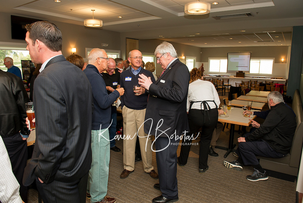 Greg Landroche and Michael Muzzey talk with LCC General Manager Jack Sullivan during the opening reception of their newly renovated dining room and bar at Laconia Country Club on Thursday evening.  (Karen Bobotas/for the Laconia Daily Sun)