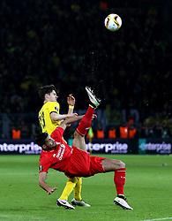 Emre Can of Liverpool acrobatically clears the ball from Julian Weigl of Borussia Dortmund - Mandatory by-line: Robbie Stephenson/JMP - 07/04/2016 - FOOTBALL - Signal Iduna Park - Dortmund,  - Borussia Dortmund v Liverpool - UEFA Europa League Quarter Finals First Leg