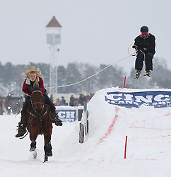 February 23, 2019 - Shakopee, MN, USA - Horses, skiers and snowboarders race down the Canterbury Park track during Extreme Horse Skijoring in Shakopee, Minn. on Saturday, Feb. 23, 2019. (Credit Image: © Shari L. Gross/Minneapolis Star Tribune/TNS via ZUMA Wire)