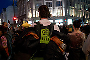 Climate protesters at Oxford Circus. After the boat was removed, many of the protesters remained, staying locked on for another night. Several roads were blocked across four sites in central London, by the Extinction Rebellion climate change protests, April 2019.