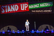 Owen Jones. The Peoples Assembly  presents: Stand Up Against Austerity. Live at the Hammersmith Apollo. London. © Andrew Aitchison / Peoples Assembly